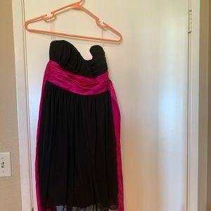 Black dress with pink ribbon